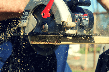 A man working on circular saw