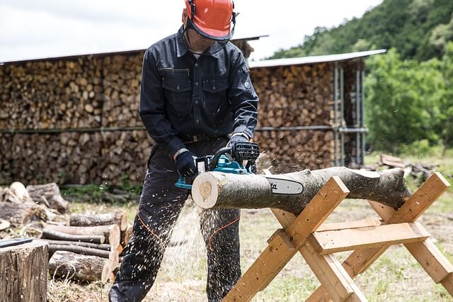 A man milling lumber with chainsaw